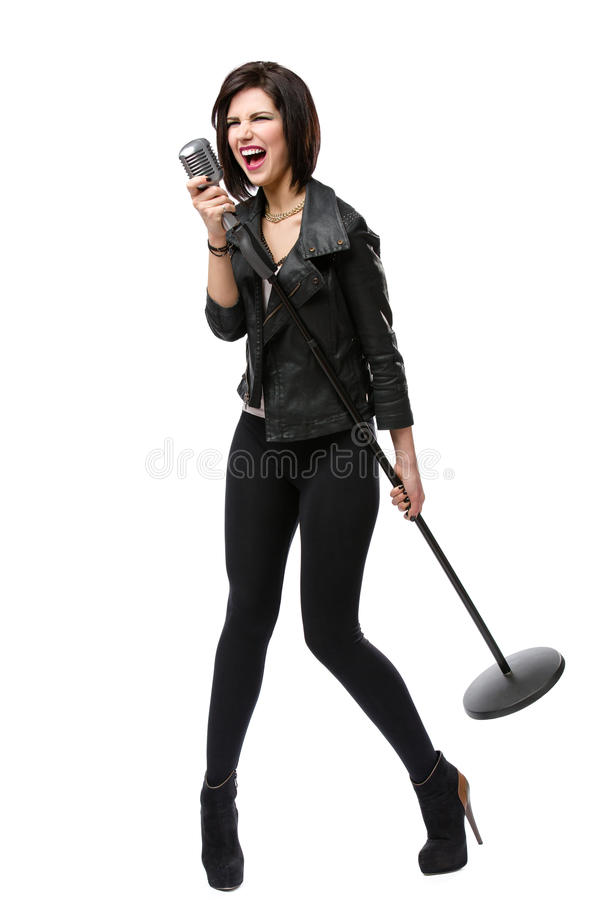 Full length of rock singer with microphone stock photography