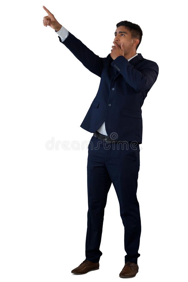 Full length of shocked businessman touching invisible interface royalty free stock photos