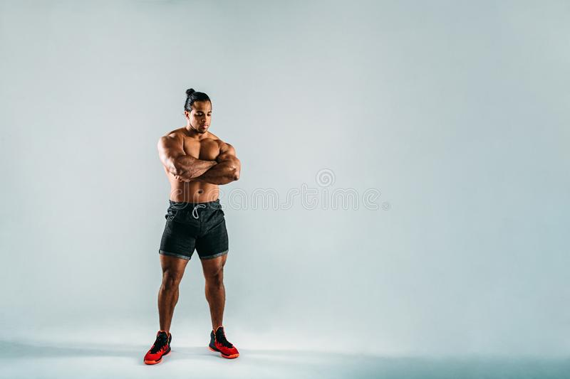 Full length shot of fitness men with his arms crossed royalty free stock photo