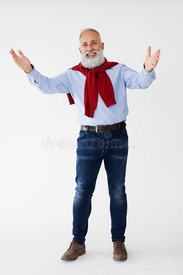 Positive mature bearded man showing greeting gesture stock photo
