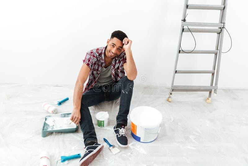 Full-length shot of man during repair between equipment stock photo