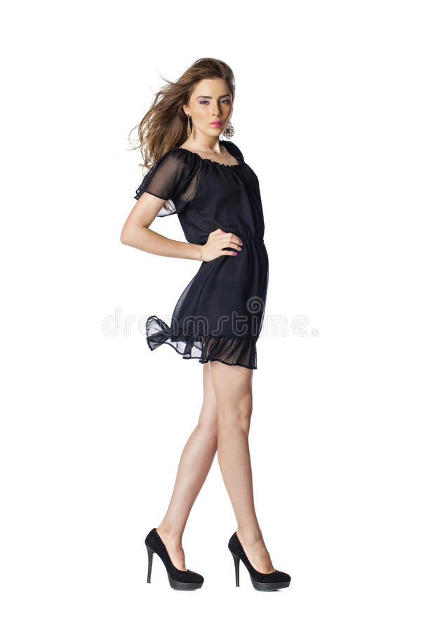 Full length shot of woman in evening black dress. Full length shot of woman in evening dress, isolated on white background stock photo