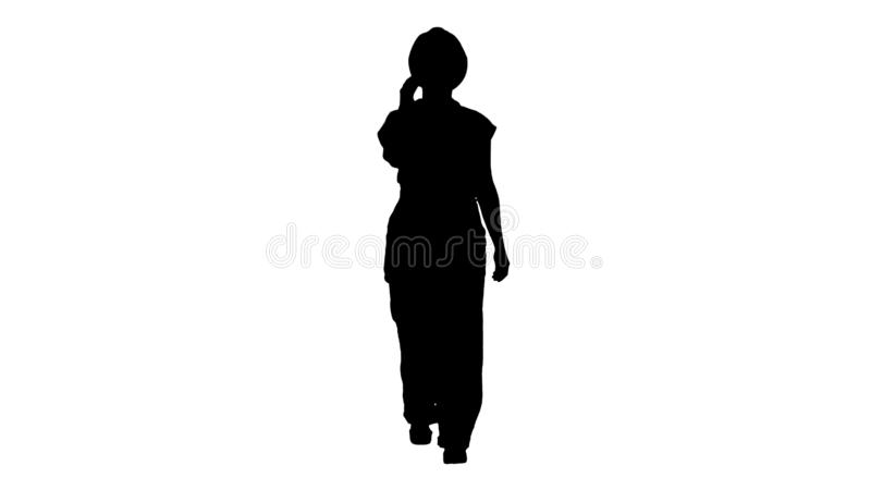 Silhouette Female construction woman making a call. stock photos