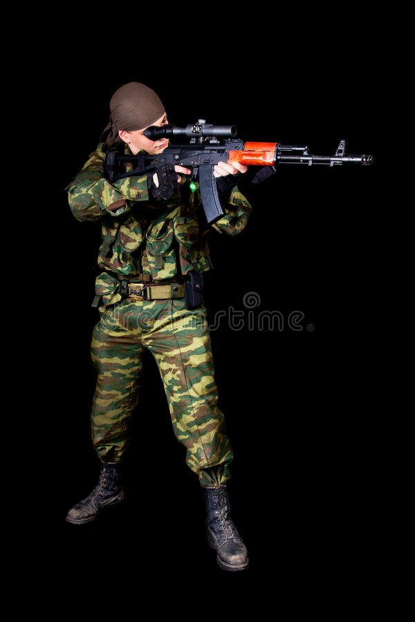 Full length shot of soldier with weapon. Isolated on black background stock images