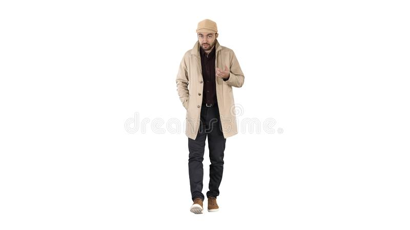 Talking young man in trench coat confidently talking to camera Just move forward on white background. royalty free stock photos