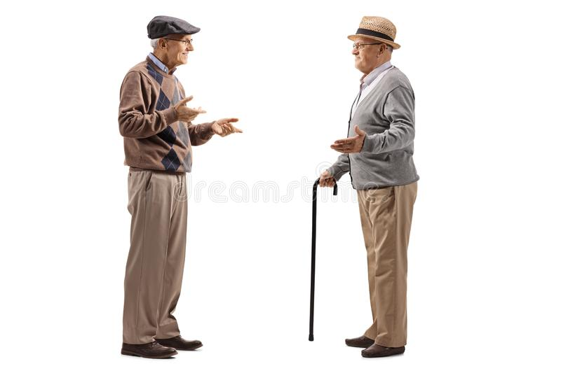Full length shot of two elderly men having a conversation. Isolated on white background stock photos