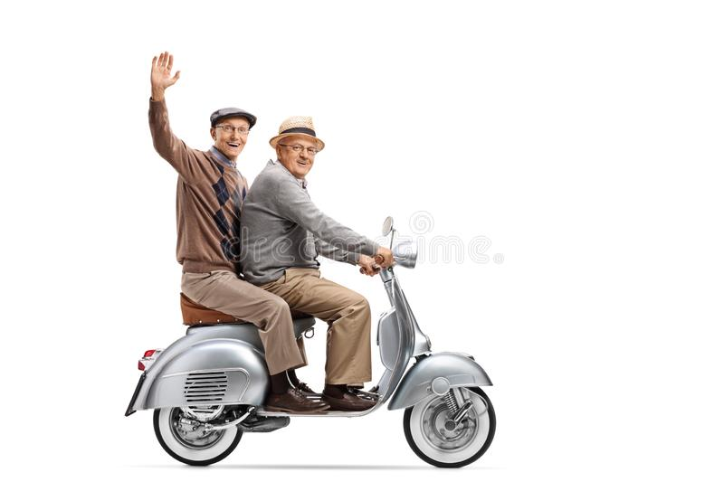 Full length shot of two elderly men on a vintage scooter, one wa. Ving isolated on white background stock photography