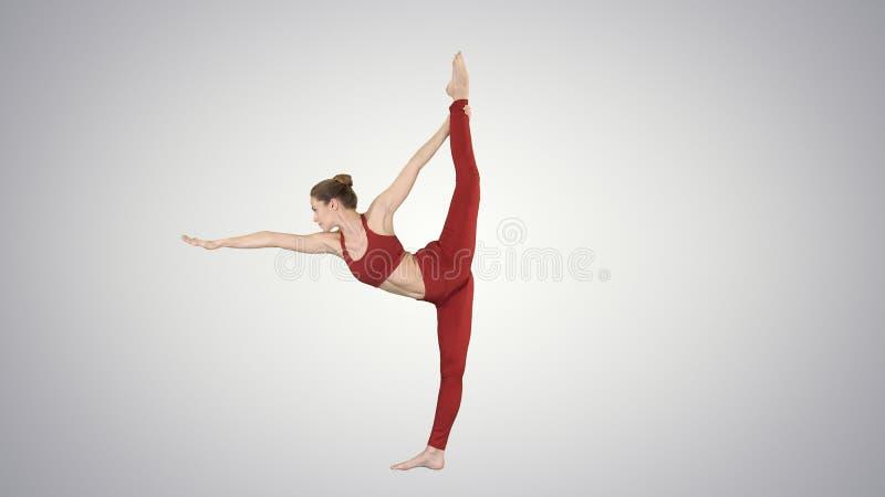 Yoga pose, woman doing stretching legs, leg split on gradient background. stock photo