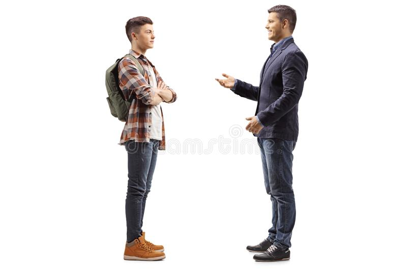 Young boy listening to a man talking royalty free stock photos