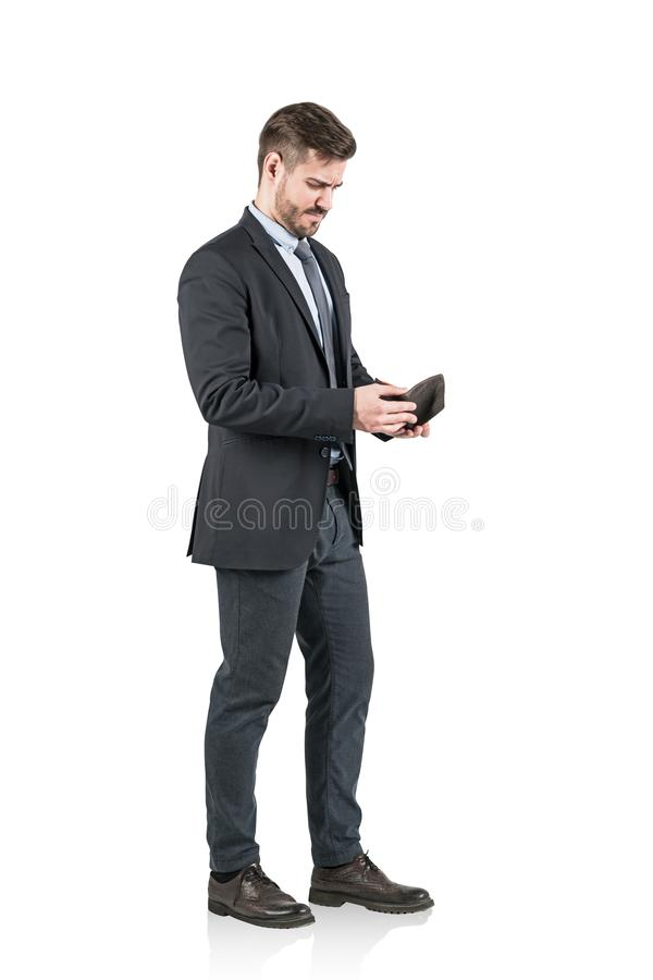 Full length shot of young Caucasian confident businessman dressed formal suit holding open wallet. isolated on white background. Full length shot of young royalty free stock photography