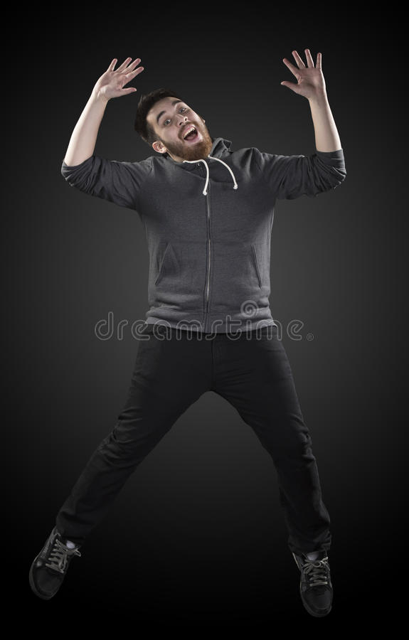 Full Length Shot of Young Man in Wacky Pose royalty free stock images