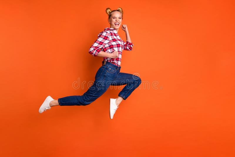 Full length side profile body size photo amazing funny she her lady jumping high sporty body shape crazy run fast. Full length side profile body size photo royalty free stock photo