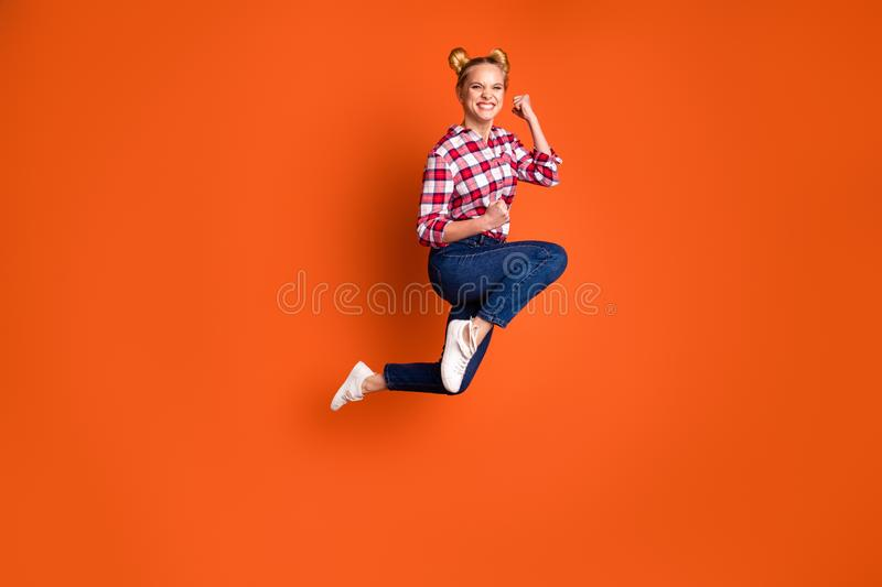 Full length side profile body size photo funny yeah she her lady jumping high sporty body shape crazy run fast shopping. Full length side profile body size photo stock photography