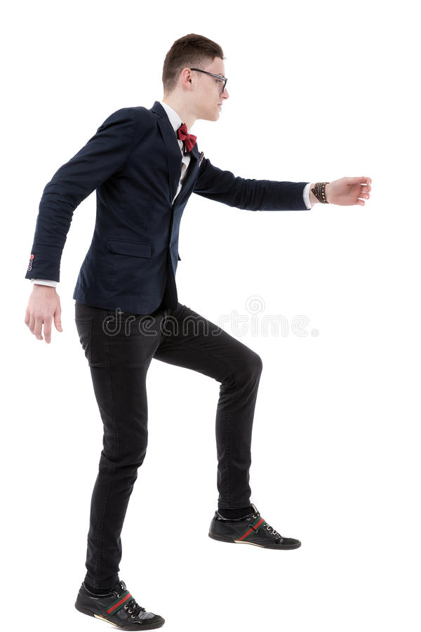 Full length side view of businessman climbing imaginary steps ag stock photos