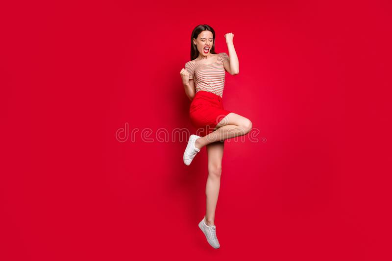 Full length size body photo of emotional mad ecstatic charming lady making gesture with fists jumping up isolated bright. Full length size body photo of royalty free stock photos