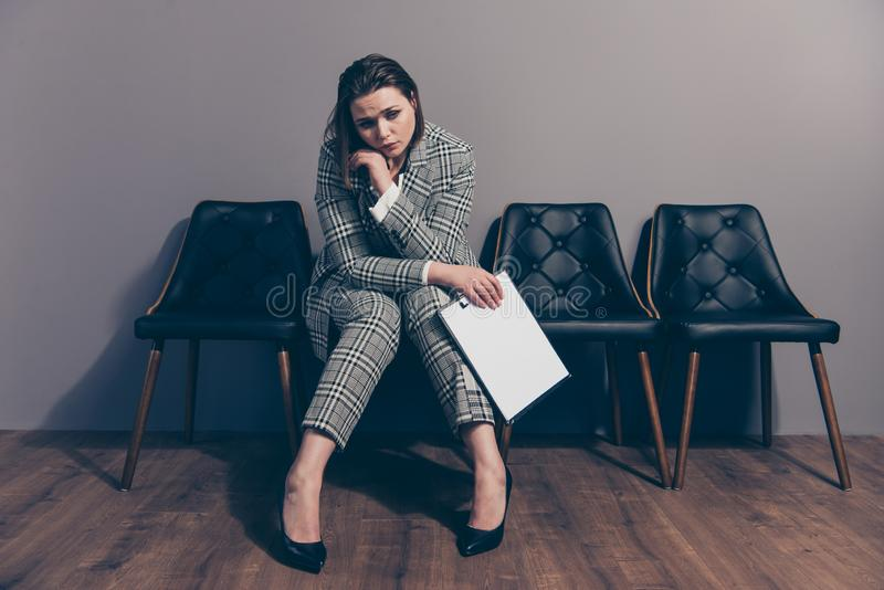 Full length size body photo portrait of unhappy confused anxious desperate she her lady sitting on modern style stylish royalty free stock photo