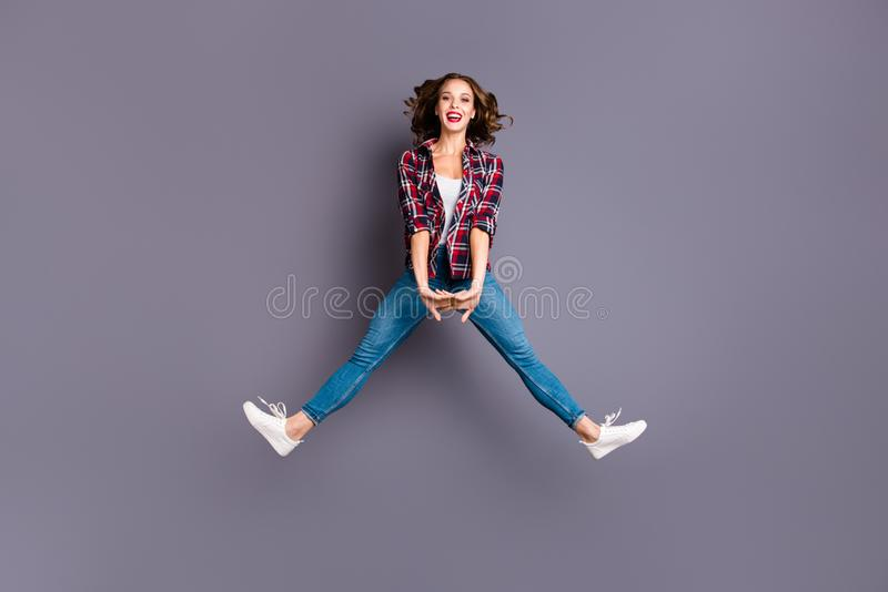 Full length size body view photo jumping high amazing attractive beautiful she her lady flight in air legs separate stock image