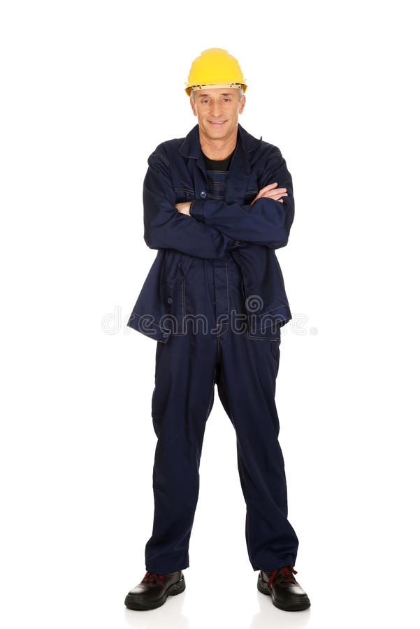 Full length smiling constructor with folded arms.  royalty free stock photos