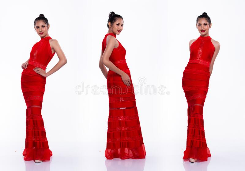 Full Length Snap Figure, Asian Woman Transgender wears Red Sexy Long Gown dress black hair and acts walk many poses directions. Forward left, studio lighting royalty free stock image