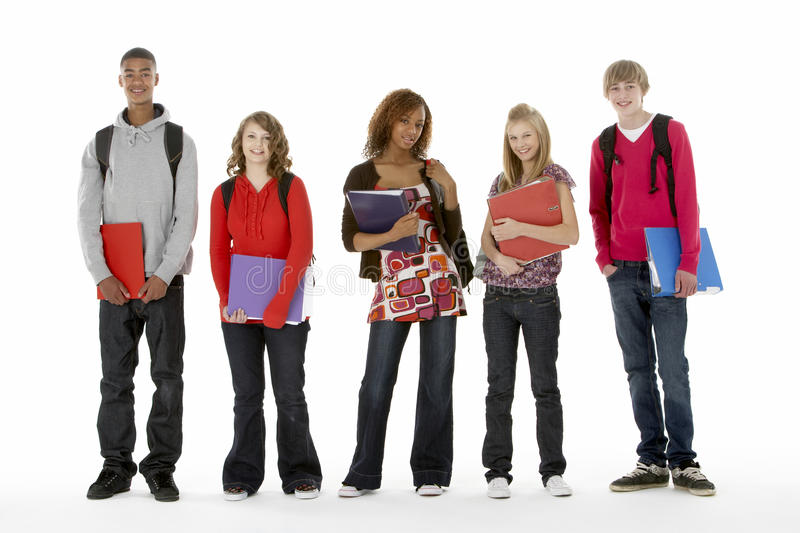 Full Length Studio Portrait Of Five Teenage Studen. Ts smiling at camera stock image