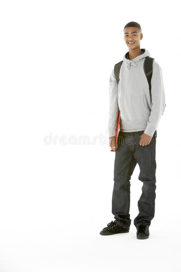 Full Length Studio Portrait Of Male Teenage Studen. T smiling at camera royalty free stock photo