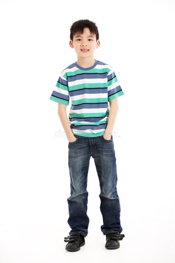 Full Length Studio Shot Of Chinese Boy. Smiling royalty free stock photo