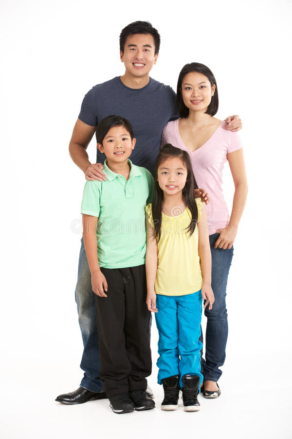 Full Length Studio Shot Of Chinese Family. Smiling stock photos