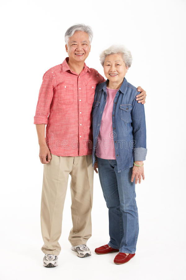 Full Length Studio Shot Of Chinese Senior Couple. Smiling stock photos