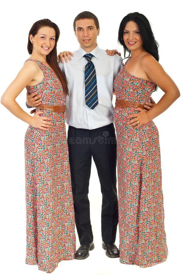 Full length of three fashion models stock image