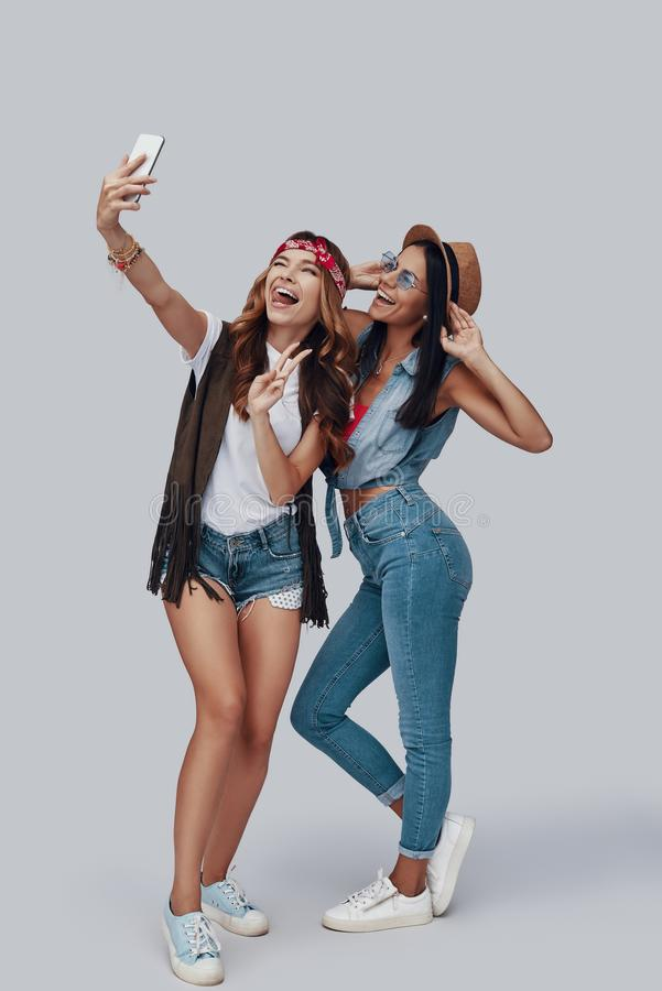 Full length of two attractive stylish young women royalty free stock photography