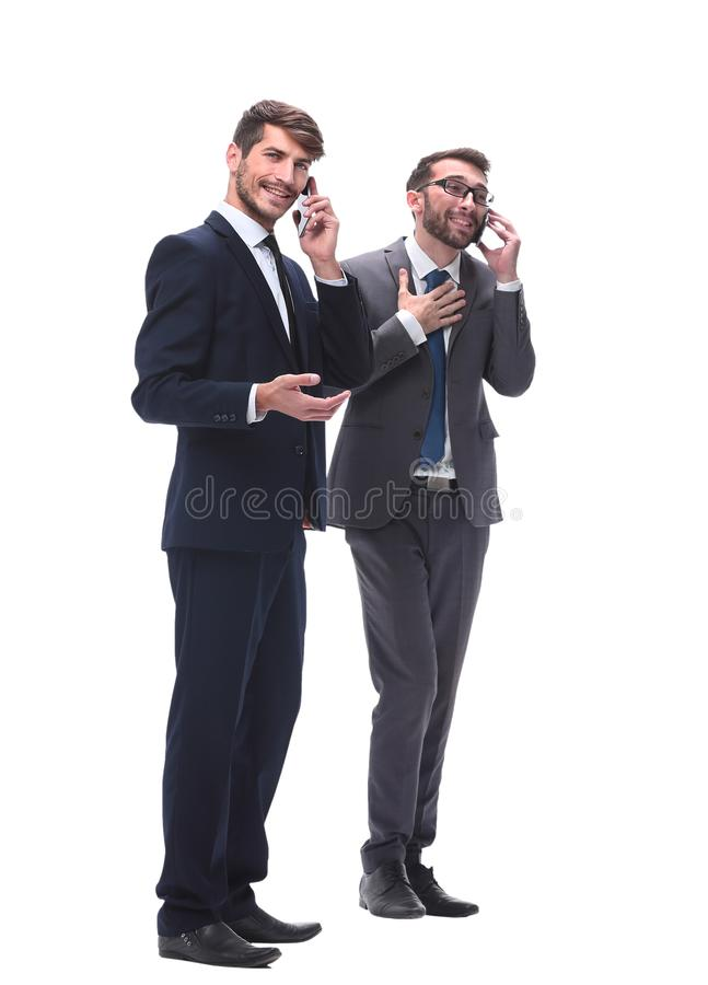 Full length . two businessmen using their smartphones royalty free stock photo