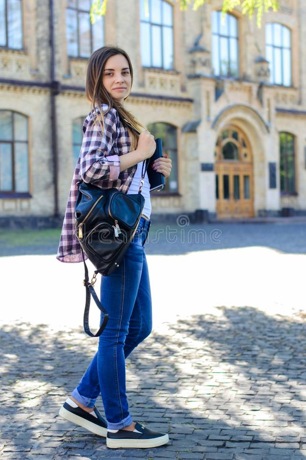 Full-length vertical portrait of confident female student in che royalty free stock image