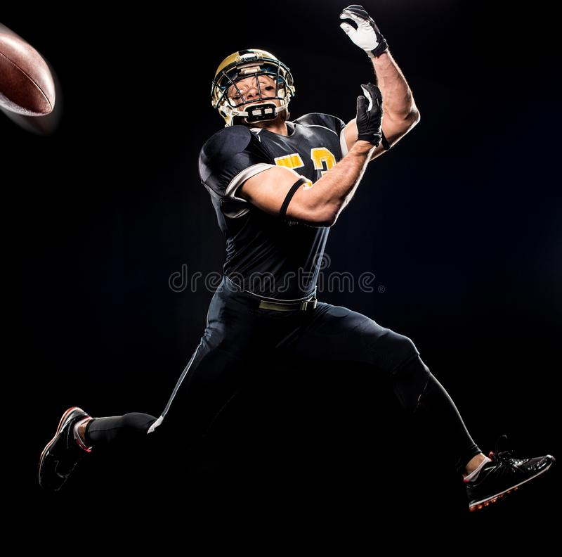 Full length view of american football player in protective sportswear catching ball royalty free stock photos