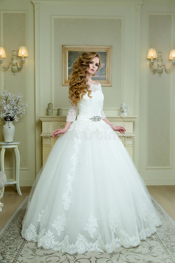 Full length view on beautiful woman posing in a wedding dress. royalty free stock photography