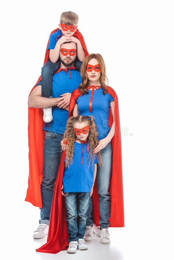 full length view of family of superheroes looking at camera royalty free stock photos