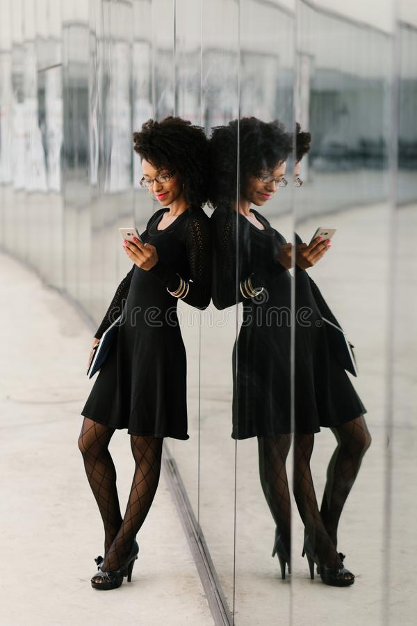 Full length view of fashionable businesswoman using cellphone stock photos