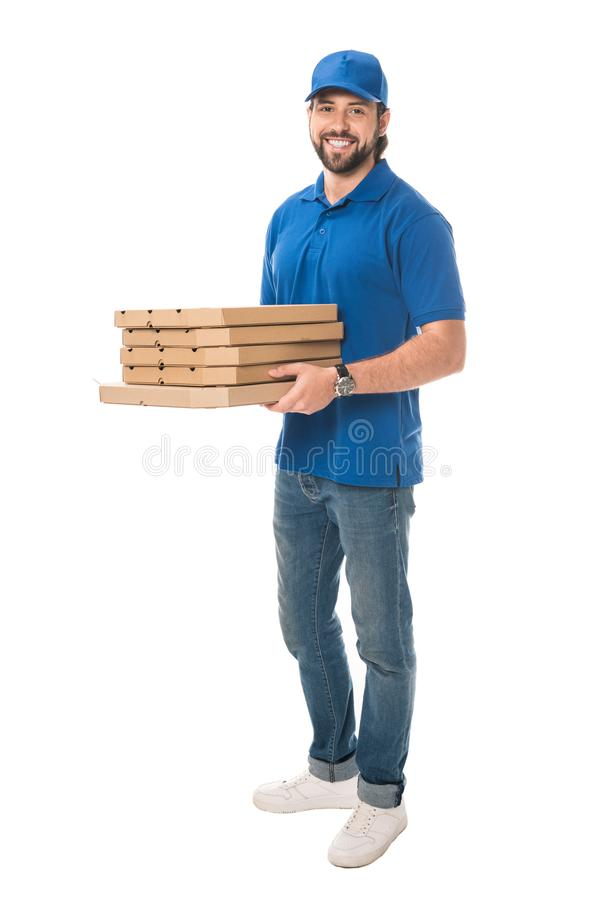 full length view of happy delivery man holding boxes with pizza and smiling at camera stock photography
