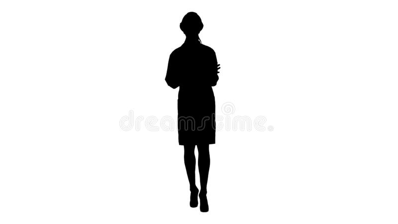 Silhouette A young beautiful woman scientist engineer in white giving lecture. stock photos