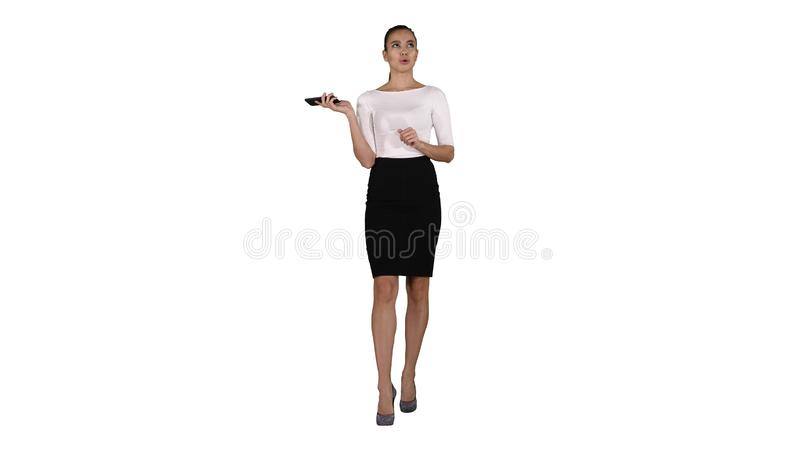 Woman shouting and argue on the phone on white background. Full length view. Woman shouting and argue on the phone on white background. Professional shot in 4K stock photos