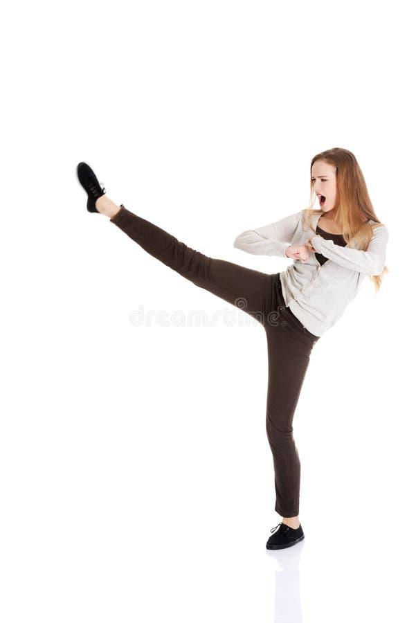 Full length woman kicking royalty free stock photos