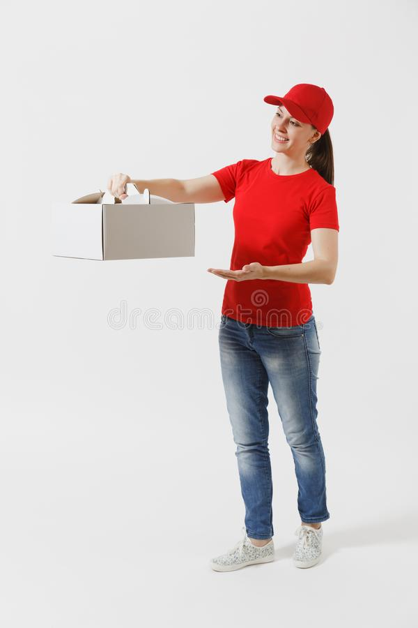 Full length of woman in red cap, t-shirt giving food order cake box isolated on white background. Female courier holding. Dessert in unmarked cardboard box royalty free stock image
