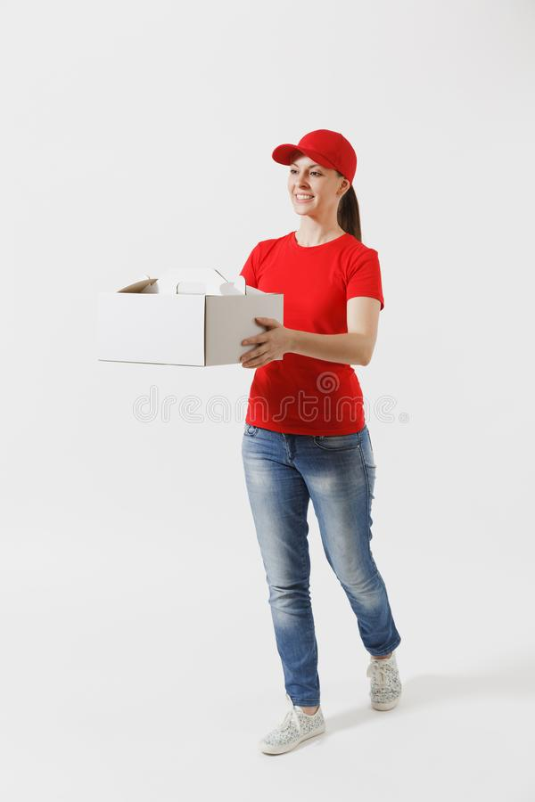 Full length of woman in red cap, t-shirt giving food order cake box isolated on white background. Female courier holding. Dessert in unmarked cardboard box stock photography