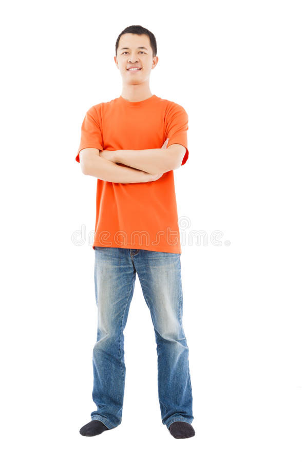 Full length of young asian man standing. Isolated on white background royalty free stock photography