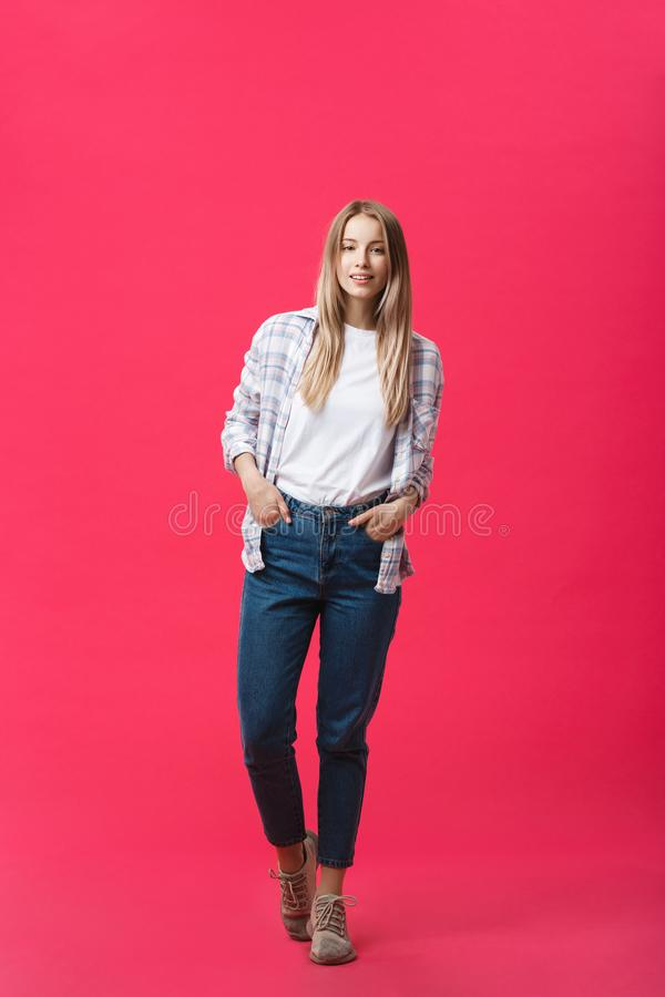 Full length young beautiful woman in casual cloth standing over pink background. royalty free stock photos
