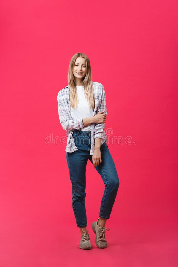 Full length young beautiful woman in casual cloth standing over pink background. royalty free stock images