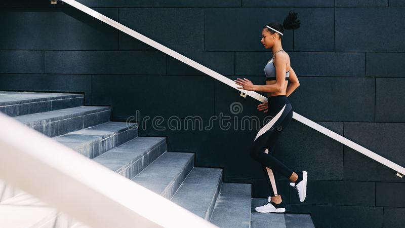 Full length of young female exercising in a city stock photos
