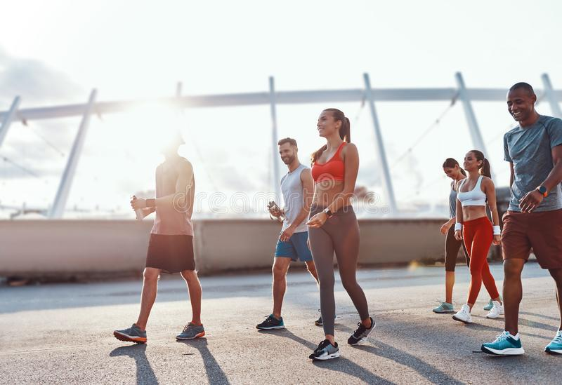 Full length of young people in sports clothing royalty free stock photography