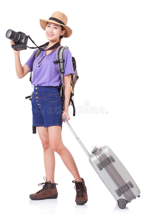 Full length of young woman in casual walking with the travel bag stock image