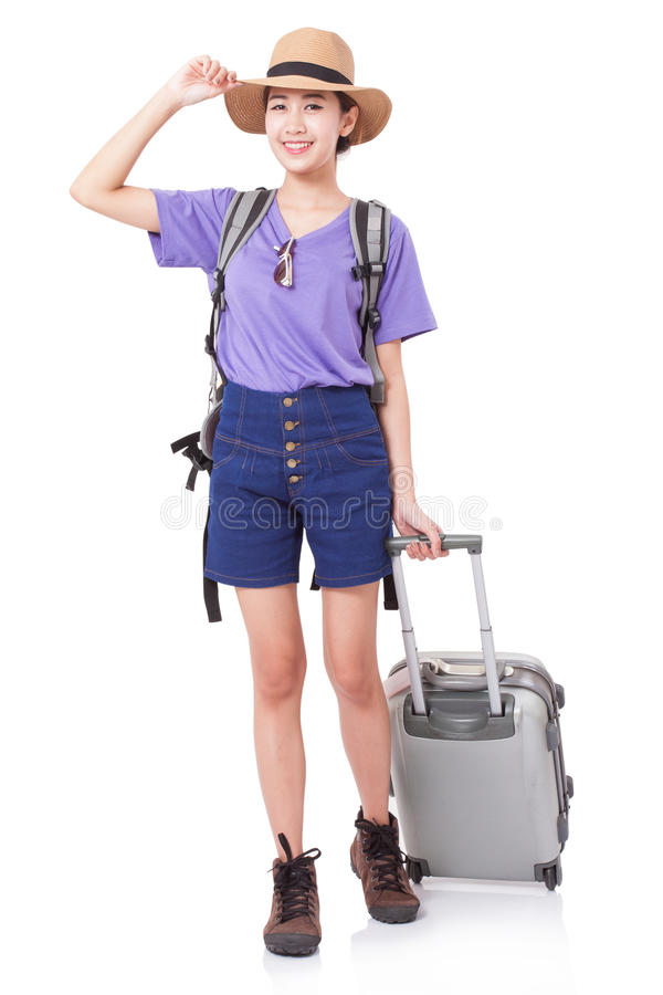 Full length of young woman in casual walking with the travel bag royalty free stock photo