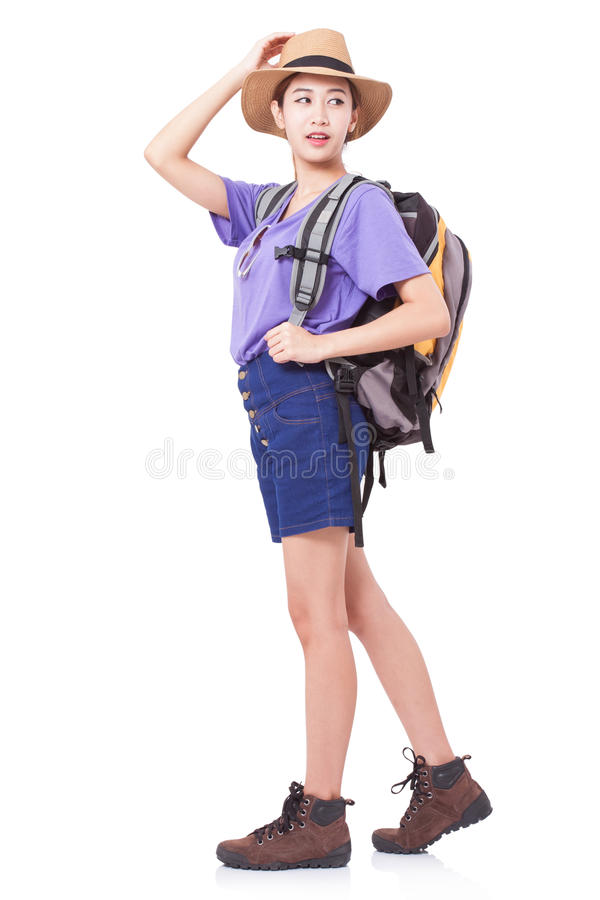 Full length of young woman in casual walking with the travel bag. stock photos